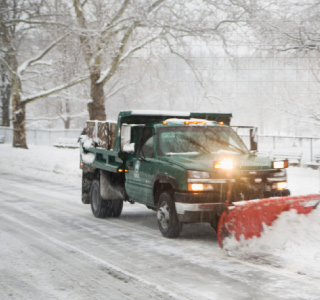 Snow plow on road